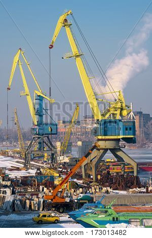 River port and loading cranes in the industrial area of the city in winter