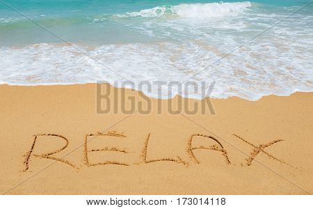 Relax message on the beach sand - vacation and travel concept
