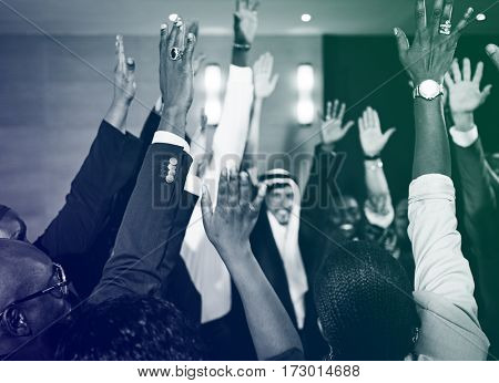Diverse business people hand raised for asking the question