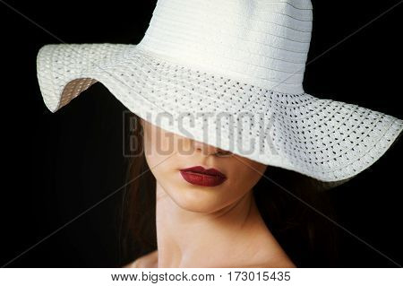 stylish portrait of a girl in hat , close-up