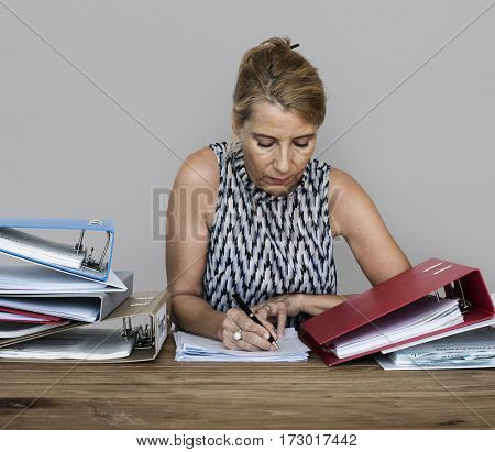 An office worker woman working on a lot of files