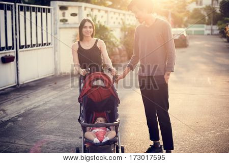 Father and mother are taking care of their child.