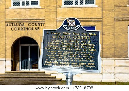 Prattville Alabama USA - January 28 2017: Side entrance to the Autauga County Courthouse with the Autauga County historic marker in the foreground.