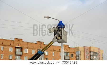electrician working at height in the aerial platform