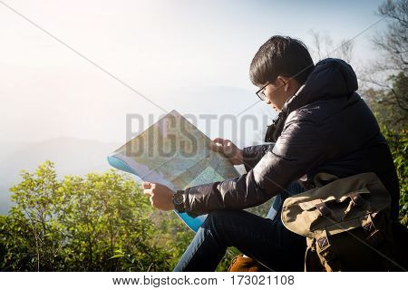 Young Man Traveler With Map Backpack Relaxing Outdoor With Rocky Mountains On Background Summer Vaca
