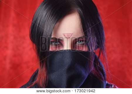 The Girl With The Covered Face On A Red Background,