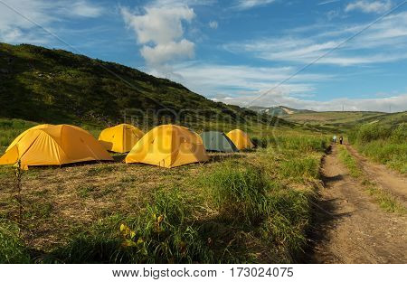 Campground in the brookvalley Spokoyny at the foot of outer north-eastern slope of caldera volcano Gorely.