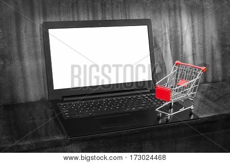 Shopping Online. Internet store and e-Commerce. Laptop and shopping cart.