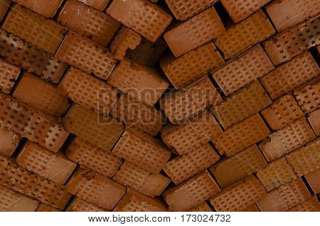 heap of the red brick laid diagonally close up