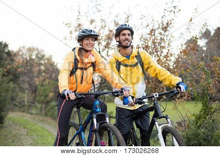 Biker couple cycling together in countryside