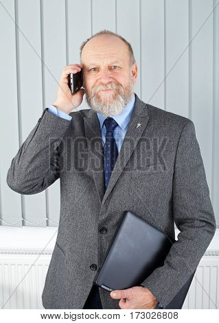 Picture of a thoughtful businessman having a phone call