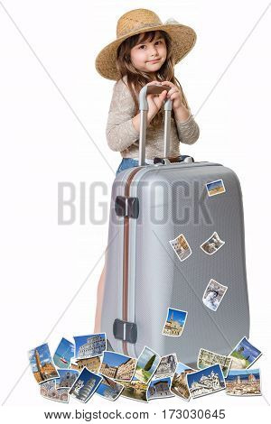 Long haired little girl with straw hat is standing and leaning on a suitcase. Photos of the sights of Tuscany (Italy) flies around the suitcase. All is on the white background. Vertically.