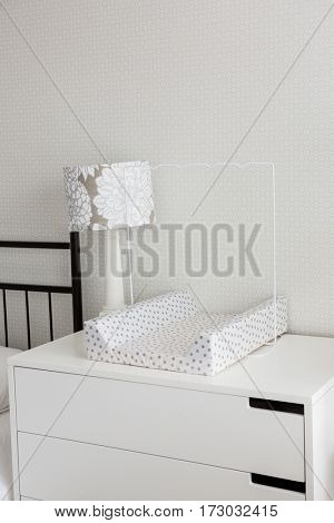 Table lamp and tray on cabinet at home