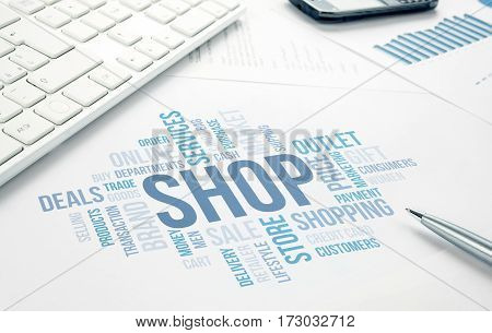 Shop concept word cloud print document keyboard pen and smartphone.
