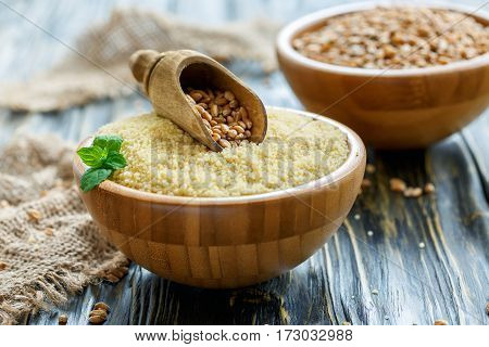 Bowl With Raw Couscous And Scoop With Wheat.