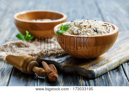 Wooden Bowls With White, Brown, Red And Wild Rice.