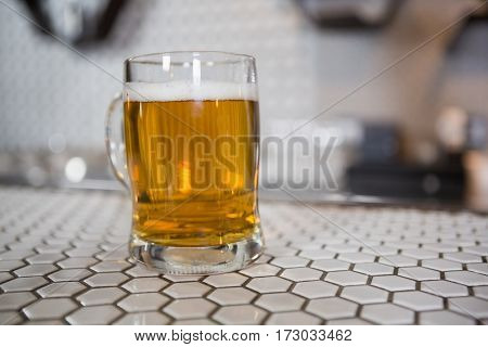 Close-up of beer glass on bar counter in bar