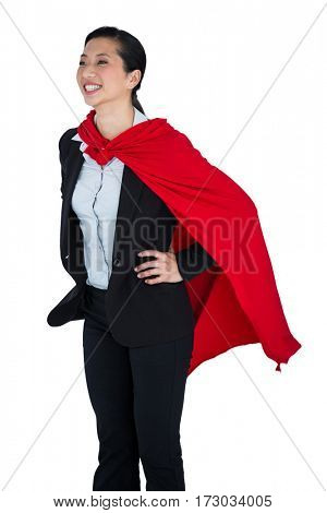 Smiling woman pretending to be a super hero on white background