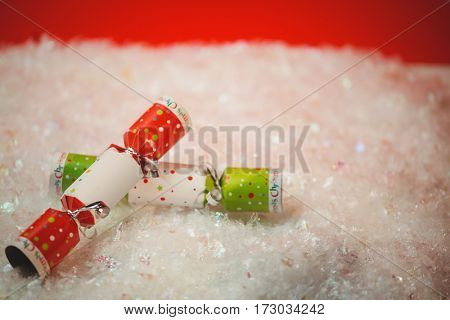 Close-up of christmas crackers on snow during christmas time