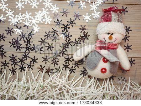 Snowman and christmas decoration on wooden table during christmas time