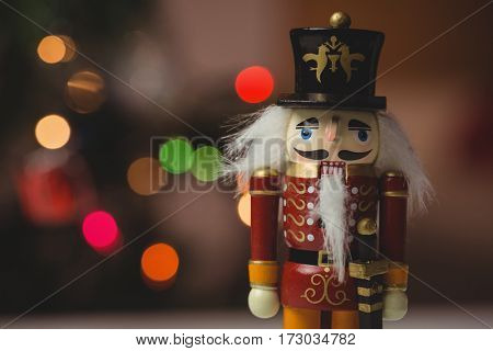 Close-up of nutcracker toy solider christmas decoration on wooden table