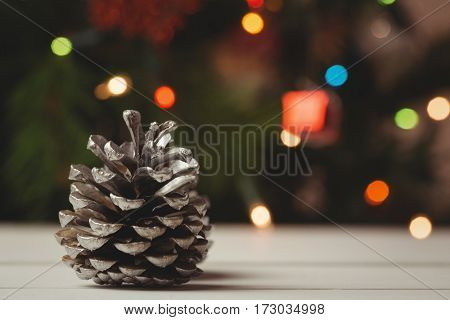 Close-up of pine cone on wooden table during christmas time