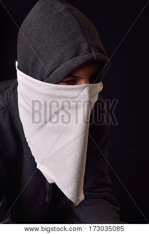 Close Up Of An Unrecognizable Young Man Wearing White Balaclava And Black Hoodie Ready To Protest At