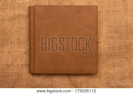 Picture Of Brown Leather Photo Album Cover On Jute Background. Keeping Memories Alive Throughout The