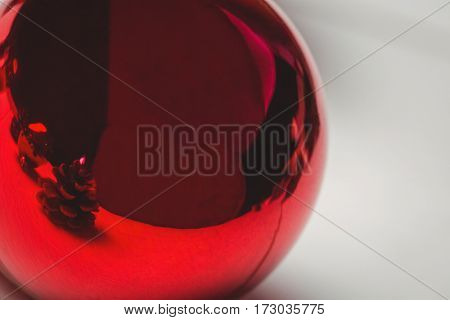 Close-up of red christmas bauble on wooden table