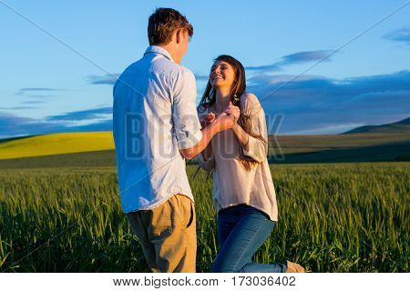 Couple having fun in field on a sunny day