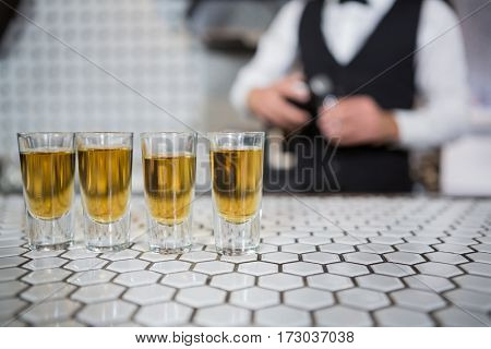 Glasses of whisky on bar counter at bar