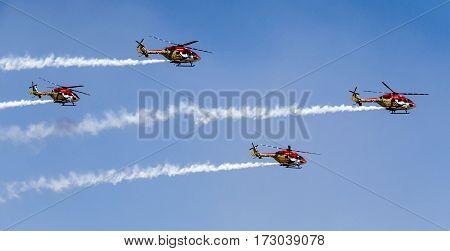 Aerobatics display of SuryaKiran helicopters at Aero show on Feb 18th, 2017 at Bangalore, Karnataka State, India