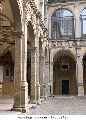tower and courtyard of Archiginnasio palace - the first official headquarters for the University of Bologna