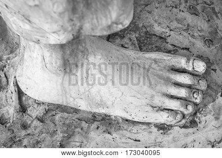 Extreme close-up of the feet of Jesus Christ. Top view. Shallow depth of field.