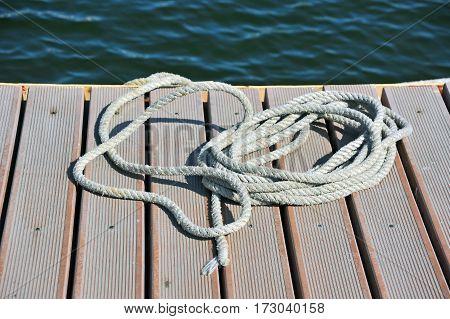 Mooring rope on old pier in port