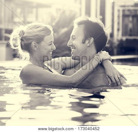 Couple cuddle enjoy in swimming pool