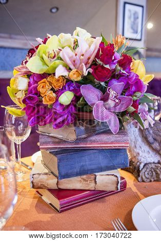 beautiful decoration of restaurant with flowers and books