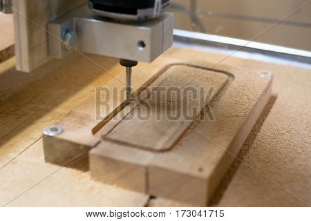 close-up of cutting wood on a CNC milling machine