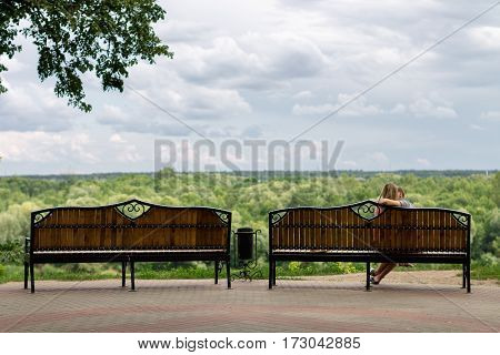 Gomel Belarus - August 24 2013: A young couple in love on a bench of city park