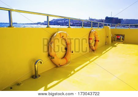 Lifebuoy on a boat's deck. Concept of safe sea walk.