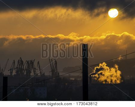 The sunrise clouds sea port and pipe plant