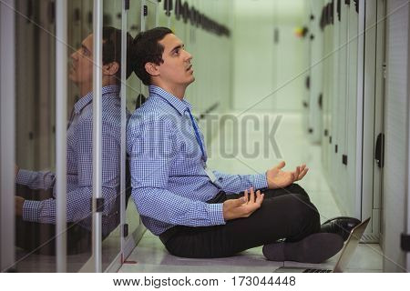 Stressed sitting on floor in server room