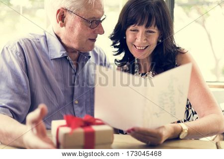 Woman reading happy anniversary card