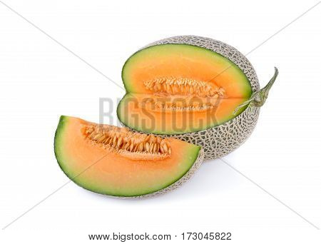 ripe cantaloupe with stem on a white background