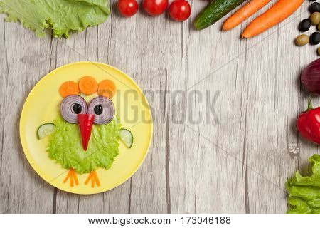 Chicken made of vegetables on table with ingredients