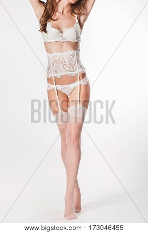 Underwear on a beautiful girl in the studio on a white background