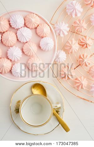 Tea time with pastels colored meringue kisses confectionary