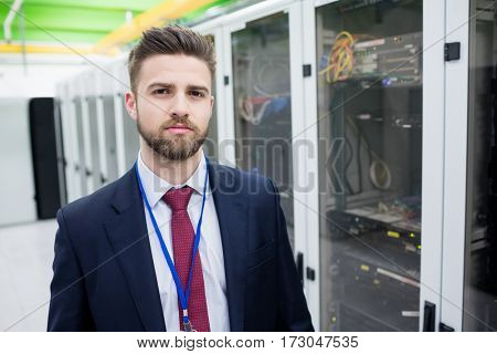 Portrait of technician standing in a server room