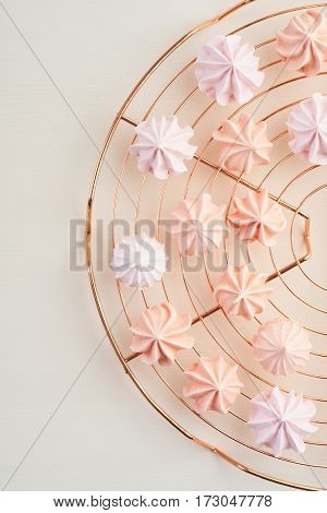 Pastels colored meringue kisses on cooling rack overhead view