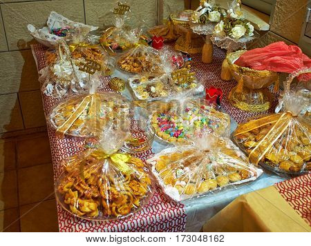 Wide selection of traditional eastern Arabic desserts sweets arranged on display in a festive celebration